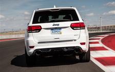 C:\Users\Olga\Downloads\ФОТКИ для структуры\Чероки\2014-Jeep-Grand-Cherokee-SRT-rear-view-in-motion.jpg